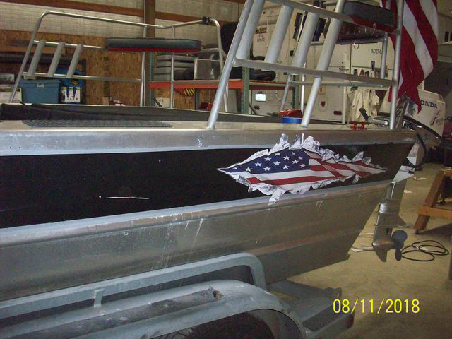 Ripped Torn Metal USA Patriotic American Flag on Boat